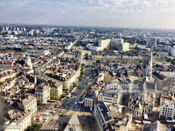 high angle view of buildings in city against sky - nantes photos et images de collection