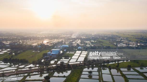 high angle view of buildings in city against sky - thai mueang photos et images de collection
