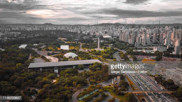 high angle view of buildings in city against sky - ibirapuera park stock pictures, royalty-free photos & images