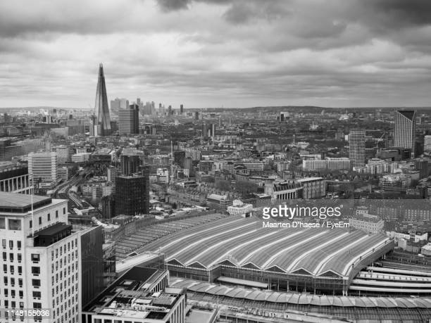 high angle view of buildings in city against sky - waterloo railway station london stock pictures, royalty-free photos & images