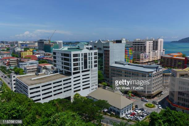 high angle view of buildings in city against sky - kota kinabalu stock pictures, royalty-free photos & images