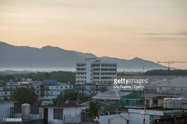 high angle view of buildings in city against sky - chanthaburi stock pictures, royalty-free photos & images
