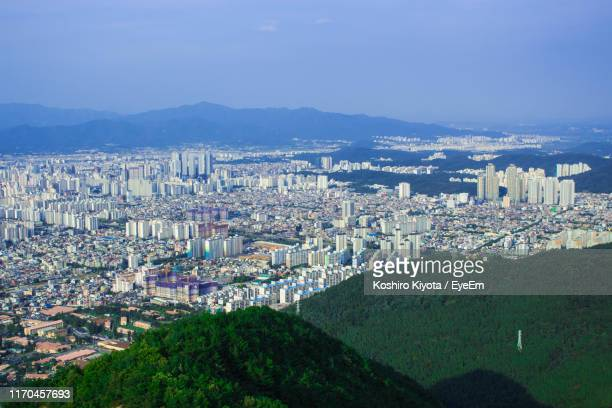high angle view of buildings in city against sky - 大邱 ストックフォトと画像