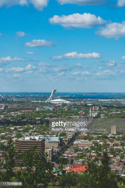high angle view of buildings in city against sky - olympic stadium stock pictures, royalty-free photos & images