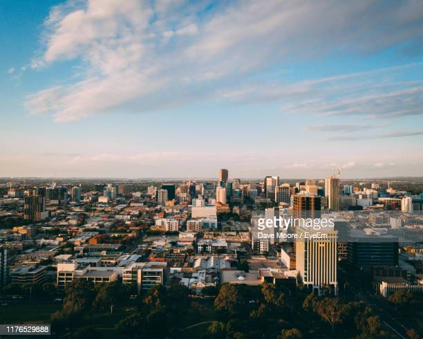 high angle view of buildings in city against sky - adelaide stock pictures, royalty-free photos & images