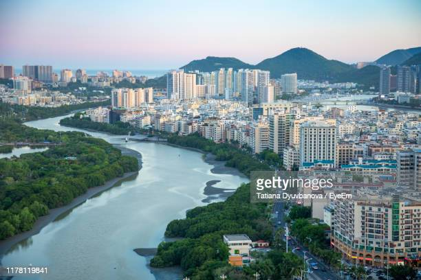 high angle view of buildings in city against sky - sanya stock pictures, royalty-free photos & images