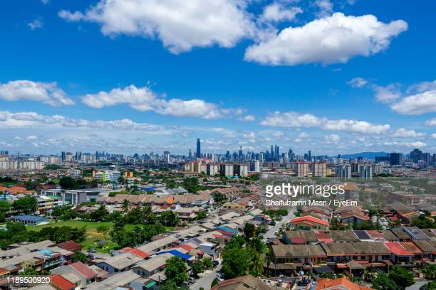 high angle view of buildings in city against sky - shaifulzamri eyeem stock pictures, royalty-free photos & images