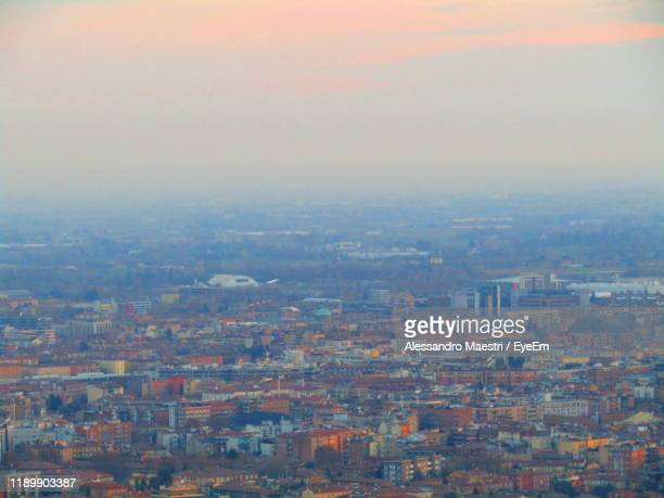 high angle view of buildings in city against sky - alessandro maestri foto e immagini stock