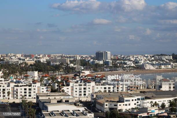 high angle view of buildings in city against sky - agadir stock pictures, royalty-free photos & images