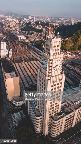 high angle view of buildings in city against sky - rua stock-fotos und bilder