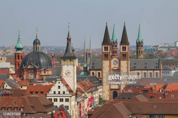 high angle view of buildings in city against sky - spire stock pictures, royalty-free photos & images