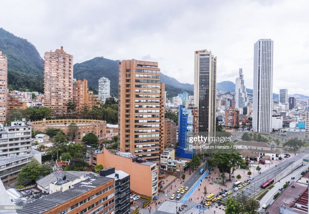 High Angle View Of Buildings In City Against Sky : Stock Photo