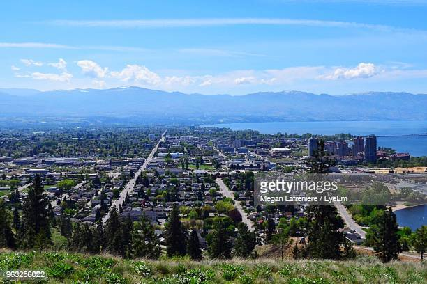 high angle view of buildings in city against sky - kelowna stock pictures, royalty-free photos & images