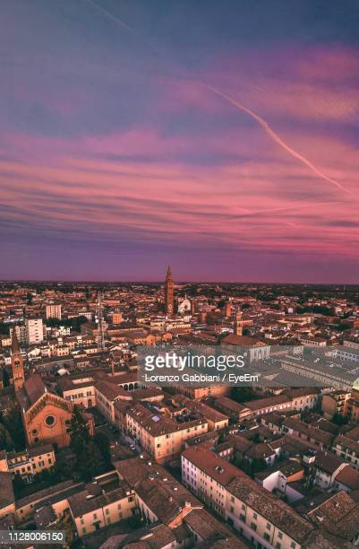 high angle view of buildings in city at sunset - cremona foto e immagini stock