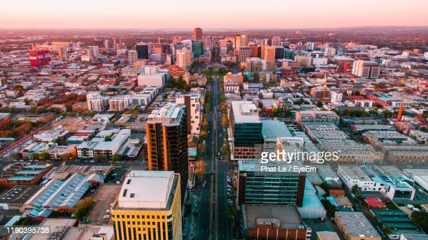 high angle view of buildings in city during sunset - adelaide city stockfoto's en -beelden