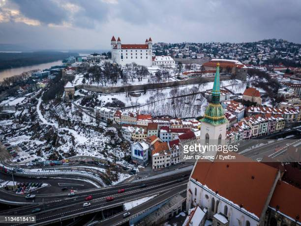 high angle view of buildings in city during winter - bratislava stock pictures, royalty-free photos & images