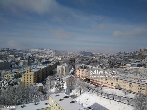 high angle view of buildings in city during winter - rhone alpes stock photos and pictures
