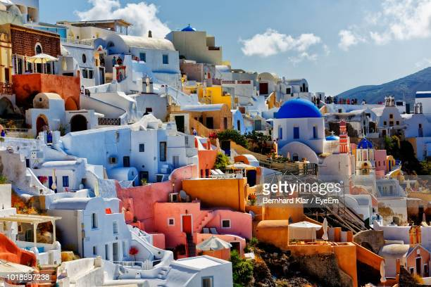 high angle view of buildings in city - santorini stock pictures, royalty-free photos & images