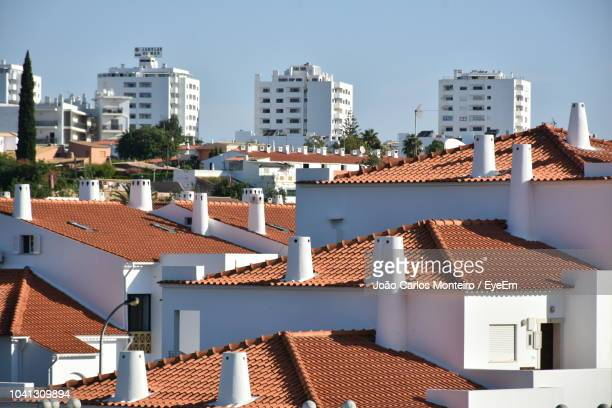 high angle view of buildings in city - albufeira stock pictures, royalty-free photos & images