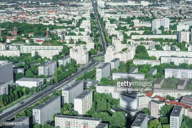 high angle view of buildings in city - stadtviertel stock-fotos und bilder