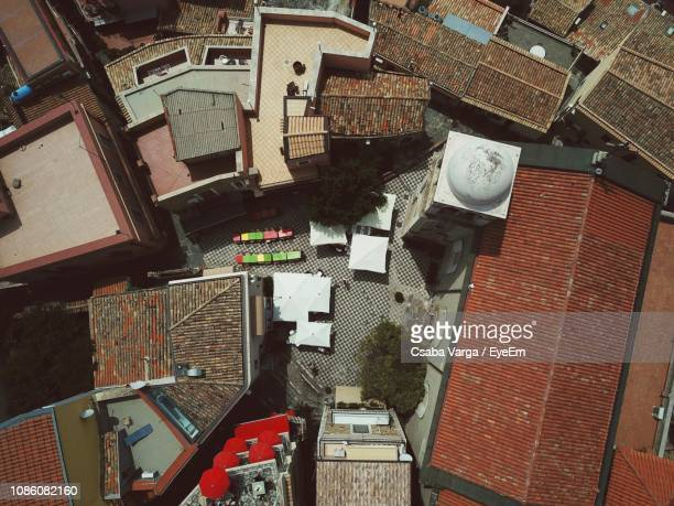 high angle view of buildings in city - castelmola stock pictures, royalty-free photos & images