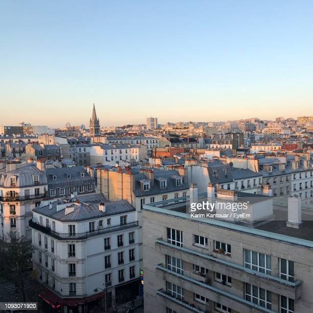 high angle view of buildings in city - toit photos et images de collection