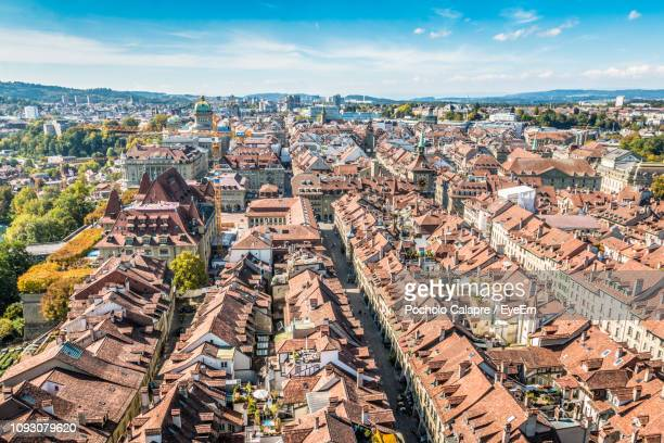 high angle view of buildings in city - bern stock photos and pictures