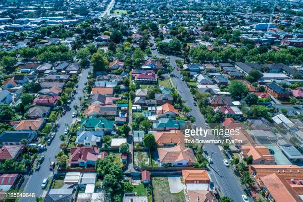 high angle view of buildings in city - chadstone shopping centre stock pictures, royalty-free photos & images