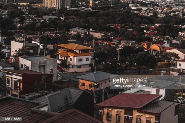 high angle view of buildings in city - jeffrey roque stock photos and pictures
