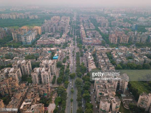 high angle view of buildings in city - new delhi stock pictures, royalty-free photos & images