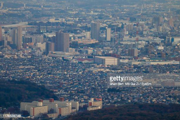 high angle view of buildings in city - hachioji stock pictures, royalty-free photos & images