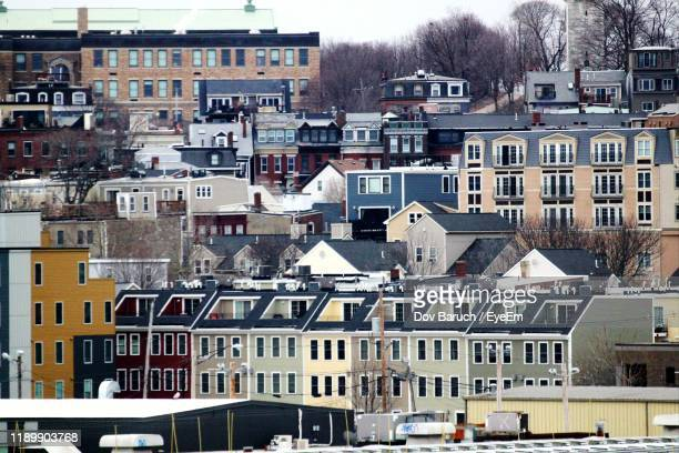 high angle view of buildings in city - barulho stock pictures, royalty-free photos & images