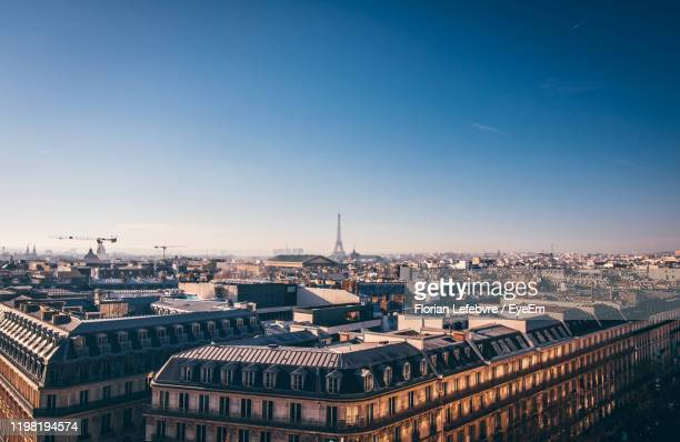 high angle view of buildings in city - paris france photos et images de collection