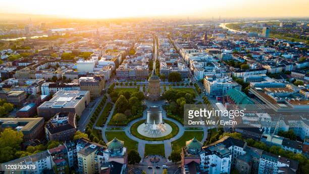 high angle view of buildings in city - mannheim stock-fotos und bilder