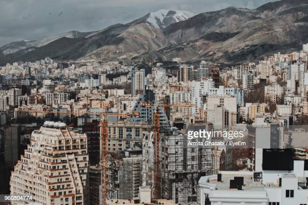 high angle view of buildings in city - tehran stock pictures, royalty-free photos & images