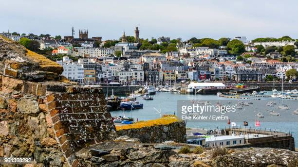 high angle view of buildings in city - isola di guernsey foto e immagini stock