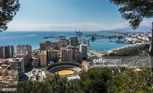 high angle view of buildings in front of sea against sky - fuengirola stock photos and pictures
