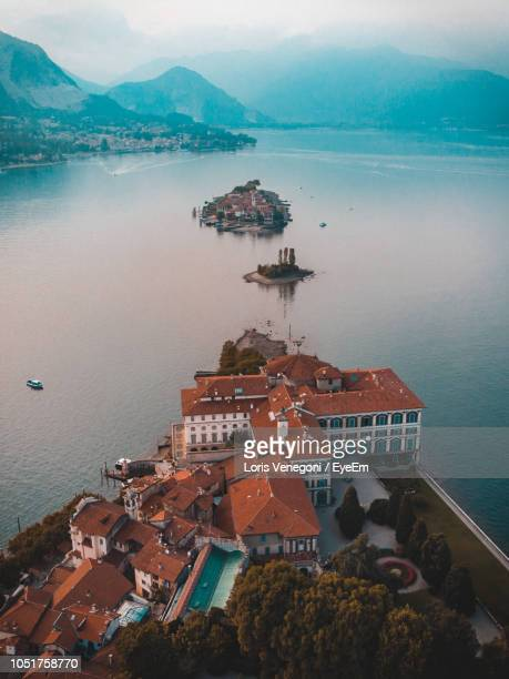 high angle view of buildings in sea - stresa stock pictures, royalty-free photos & images