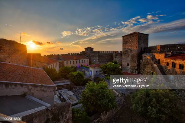 high angle view of buildings in town against sky during sunset - thessaloniki stock pictures, royalty-free photos & images