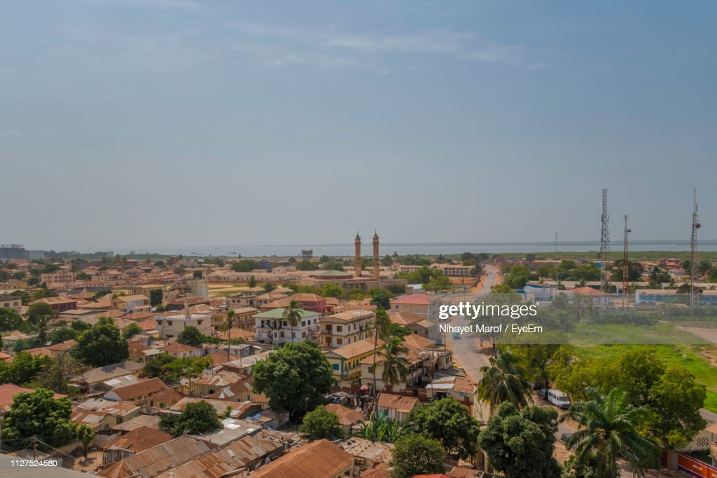 High Angle View Of Buildings In Town Against Sky : Stock Photo