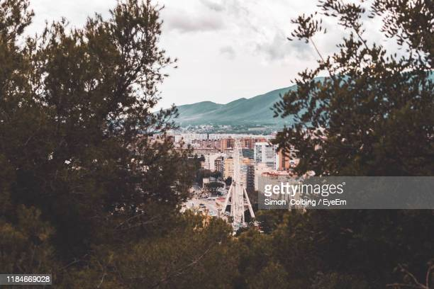 high angle view of buildings in town against sky - colbing stock pictures, royalty-free photos & images