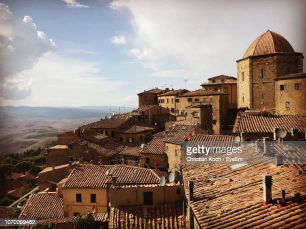 high angle view of buildings in town - volterra stock photos and pictures