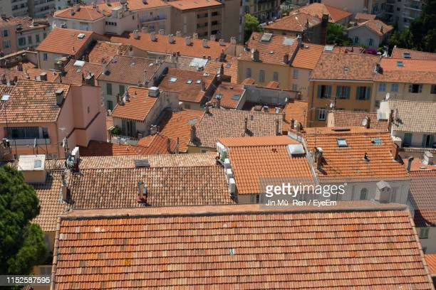 high angle view of buildings in town - cannes stock pictures, royalty-free photos & images