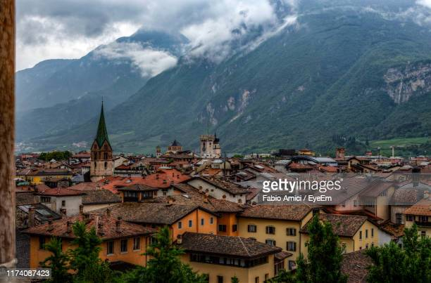 high angle view of buildings in town - trento foto e immagini stock