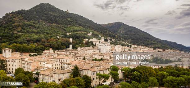 high angle view of buildings in town - gubbio stock pictures, royalty-free photos & images