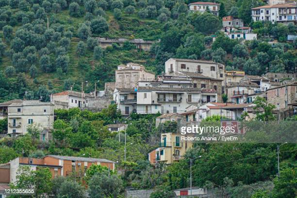 high angle view of buildings in town - calabria stock pictures, royalty-free photos & images