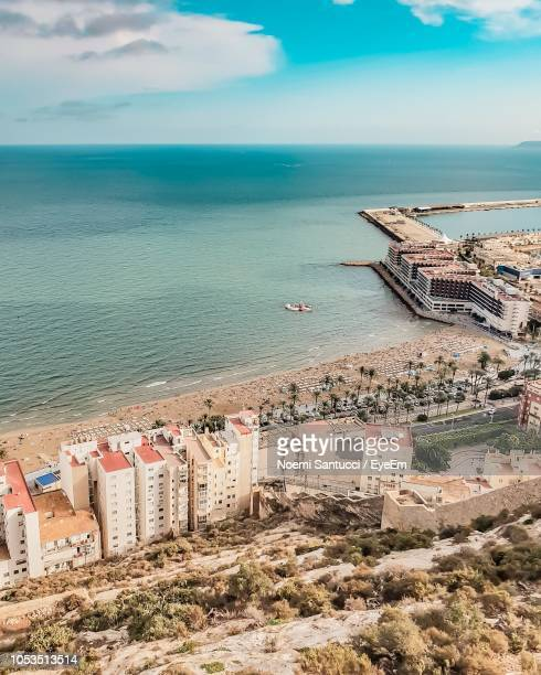 high angle view of buildings on beach - alicante stock pictures, royalty-free photos & images