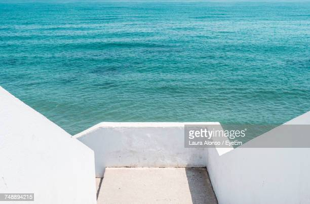 high angle view of built structure by sea - fuengirola stock photos and pictures