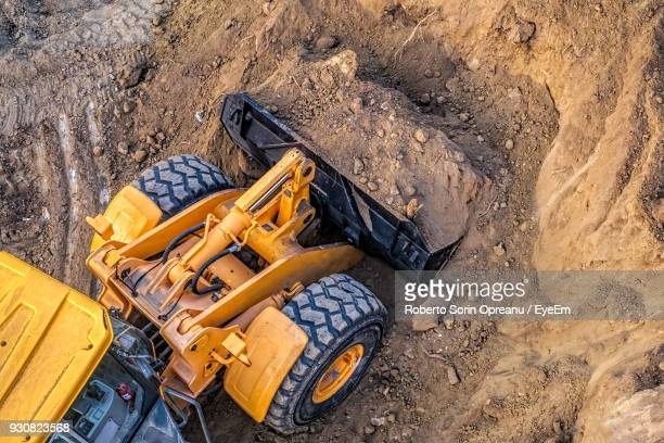 high angle view of bulldozer moving dirt - byggmaskiner bildbanksfoton och bilder