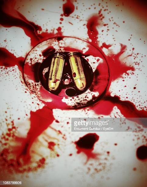high angle view of bullets and blood messed in bathroom sink - blood in sink stock pictures, royalty-free photos & images
